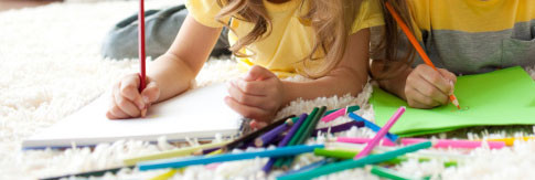 Children colouring in.